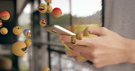 lol : Animation of emoji icons flying from left to right with a mid section of a young Caucasian woman holding a coffee cup and using a smartphone in the background 4k