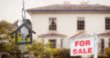 для продажи : Animation of silver house keys and house shaped key fob hanging over an out of focus house with a For Sale sign 4k Стоковые видеозаписи
