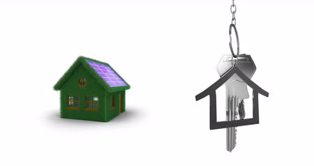 反射する : Animation of silver house keys and house shaped key fob hanging over a green house and white background 4k