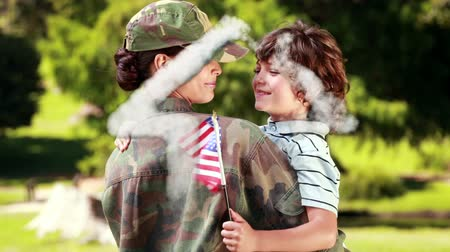 caseiro : Animation of a house shape made of cloud floating with a Caucasian soldier woman holding her son with an American flag in the background