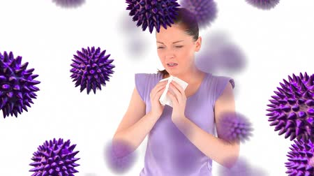 антибиотик : Animation of purple 3d viruses with an ill Caucasian woman sneezing and blowing her nose in the background Стоковые видеозаписи