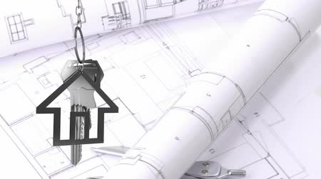 kompas : Animation of silver house keys and house shaped key fob hanging over a rotating architectural drawing and a compass in the background