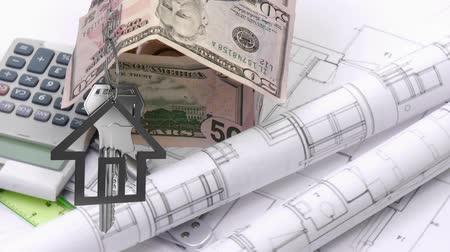 us banknotes : Animation of silver house keys and house shaped key fob hanging over a rotating architectural drawing, a calculator, a house made with US dollar bills, a ruler and a compass in the background