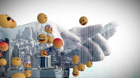 emoticon : Animation of emoji icons flying from left to right with a mid section of a man using a smartphone and cityscape in the background Stock Footage