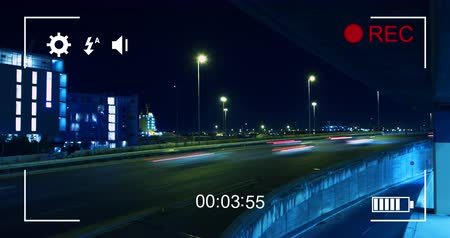 modo : Animation of night traffic in fast motion, seen on a screen of a digital camera in record mode with icons and timer 4k Stock Footage