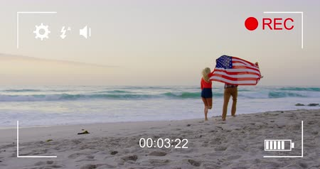 načasování : Animation of a young Caucasian couple on a beach running with an American flag, seen on a screen of a digital camera in record mode with icons and timer 4k Dostupné videozáznamy