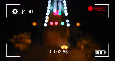 modo : Animation of blurred city lights at night and cityscape, seen on a screen of a digital camera in record mode with icons and timer 4k