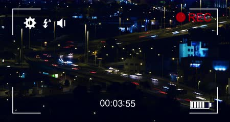 načasování : Animation of night traffic in fast motion and cityscape, seen on a screen of a digital camera in record mode with icons and timer 4k