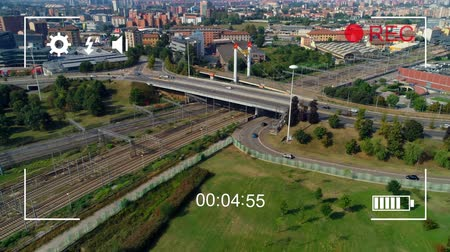načasování : Animation of aerial view of urban traffic, seen on a screen of a digital camera in record mode with icons and timer