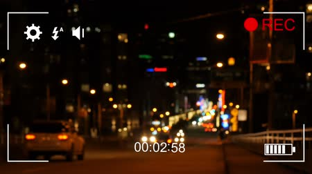 načasování : Animation of night traffic, seen on a screen of a digital camera in record mode with icons and timer
