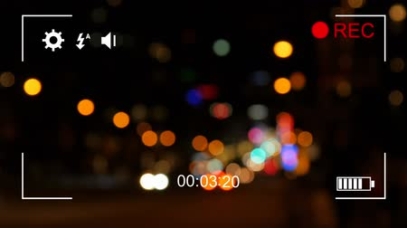 načasování : Animation of defocused night traffic, seen on a screen of a digital camera in record mode with icons and timer