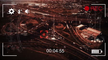 načasování : Animation of aerial view of urban traffic with a pointer on a road scanning, seen on a screen of a digital camera in record mode with icons and timer