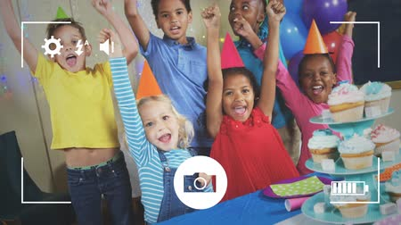 mode : Animation of a group of multi-ethnic children at a birthday party, seen on a screen of a smartphone in picture mode with icons in the foreground