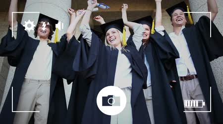companionship : Animation of a group of Caucasian students graduating and celebrating with arms in the air, seen on a screen of a smartphone in picture mode with icons in the foreground