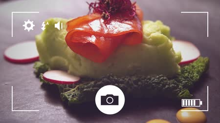 пюре : Animation of a close up of mashed potatoes with salmon and vegetables, seen on a screen of a smartphone in picture mode with icons in the foreground