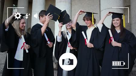 fotolijst : Animation of a group of Caucasian students graduating and celebrating throwing their hats in the air, seen on a screen of a smartphone in picture mode with icons in the foreground