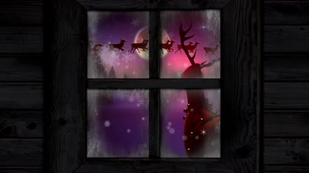 jodła : Animation of winter scenery seen through window, with Santa Claus in sleigh being pulled by reindeers, snowfall, moon and a reindeer Wideo