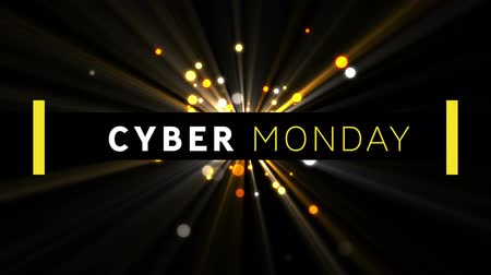 hétfő : Animation of the words Cyber Monday in white and yellow letters with light trails on a black background Stock mozgókép