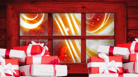 légköri : Animation of winter scenery seen through window, with snowfall, red and yellow abstract background and presents