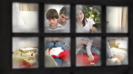 légköri : Animation of family at Christmas seen through a window by a Christmas tree giving each other presents