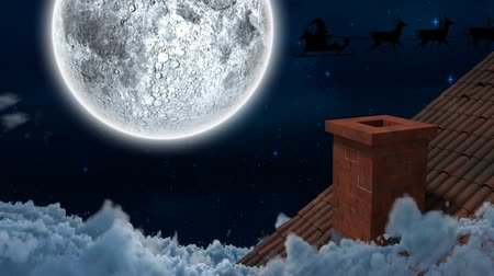 sob : Animation of winter scenery at night with Santa Claus in sleigh being pulled by reindeers, snow, moon and house