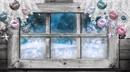 безделушка : Animation of winter scenery seen through window, with snowfall and Christmas tree with baubles in the foreground Стоковые видеозаписи