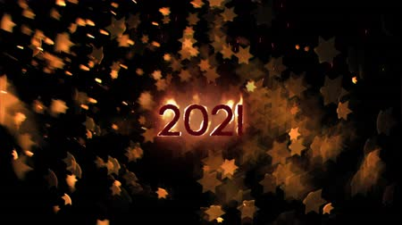 légköri : Animation of the number 2021 in flames with moving stars on a black background
