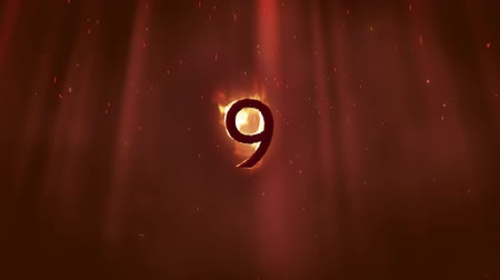 devět : Animation of the number 9 in flames on an orange background