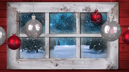 önemsiz şey : Animation of winter scenery seen through window, with snowfall, baubles and fir trees Stok Video