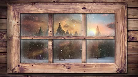 christmas spirit : Animation of winter scenery seen through window, with snowfall and fir trees