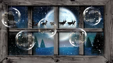 önemsiz şey : Animation of winter scenery seen through window, with Santa Claus in sleigh being pulled by reindeers, snowfall, moon, glass baubles and fir trees