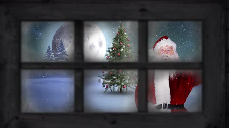 légköri : Animation of winter scenery seen through window, with Santa Claus waving, snowfall, moon and Christmas tree
