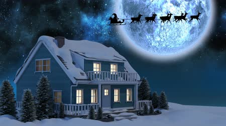 sob : Animation of winter scenery at night with Santa Claus in sleigh being pulled by reindeers, moon and house Dostupné videozáznamy