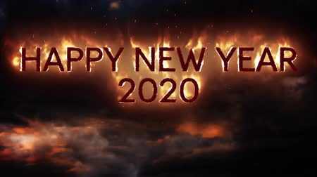 chamejante : Animation of the words Happy New Year 2020 in flames with fireworks on a black background