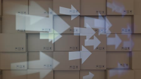 양산 : Animation of white arrows moving over stacked cardboard boxes in the background 무비클립