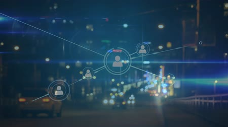 sharing : Animation of network of connecting people icons with cityscape in the background Stock Footage