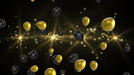 globo helio : Animation of rotating spotlights and shiny black and gold balloons floating up on a black background