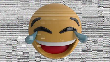 emoticon : Animation of a laughing LOL emoji icon on a pale background with interference Stock Footage