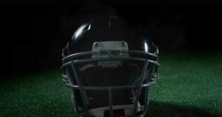 antecipação : Animation of close up of an American football player in a helmet on a field with clouds of smoke 4k