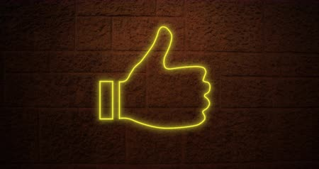 hoşlanmak : Animation of a yellow thumbs up neon sign on brick wall 4k