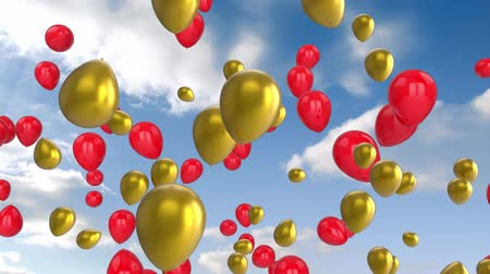 sobressalente : Animation of red and gold balloons floating with blue sky with clouds in the background