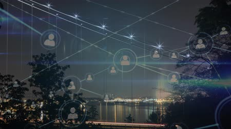 crescimento : Animation of network of connecting people icons with cityscape in the background Vídeos