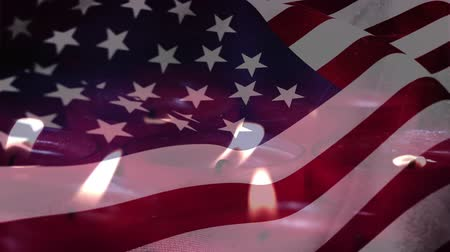 благодарение : Animation of lit candles burning with a US flag billowing in the background