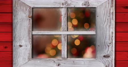 christmas spirit : Animation of defocused Christmas lights seen through a window 4k Stock Footage