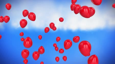 празднования : Animation of red balloons floating with blue sky in the background Стоковые видеозаписи