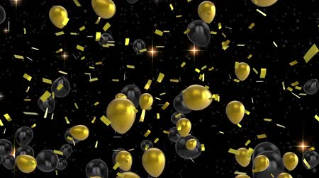 boş zaman : Animation of black and gold balloons floating and gold confetti falling on a black background