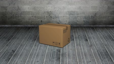 poczta : Animation of a cardboard box falling on a floor Wideo