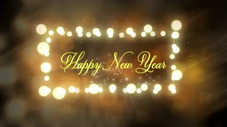 négyszögletes : Animation of the words Happy New Year written in yellow letters in a rectangular frame of glowing fairy lights with glowing orange lights in the background