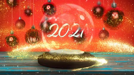 bin : Animation of number 2021 written in white letters on a snow globe, yellow shooting star  and Christmas baubles on red background