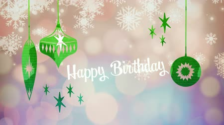önemsiz şey : Animation of the words Happy Birthday written in white letters with Christmas baubles drawn in green, in front of defocused lights and snowflakes Stok Video